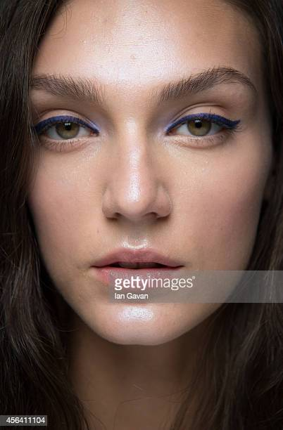 A model poses backstage before the Shiatzy Chen Spring/Summer 2015 show at the Grand Palais on September 30 2014 in Paris France