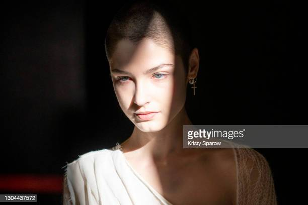Model poses backstage before the Sportmax Fashion show during the Milan Women's Fashion Week Fall/Winter 2021/2022 on February 27, 2021 in Milan,...