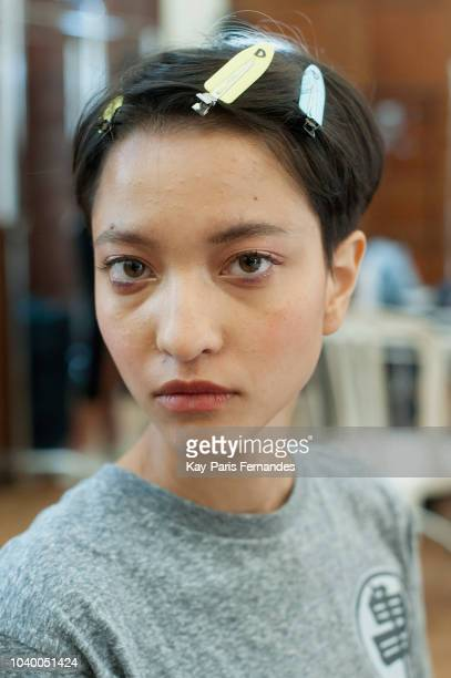 A model prepares backstage before the Victoria/Tomas show as part of the Paris Fashion Week Womenswear Spring/Summer 2019 on September 25 2018 in...