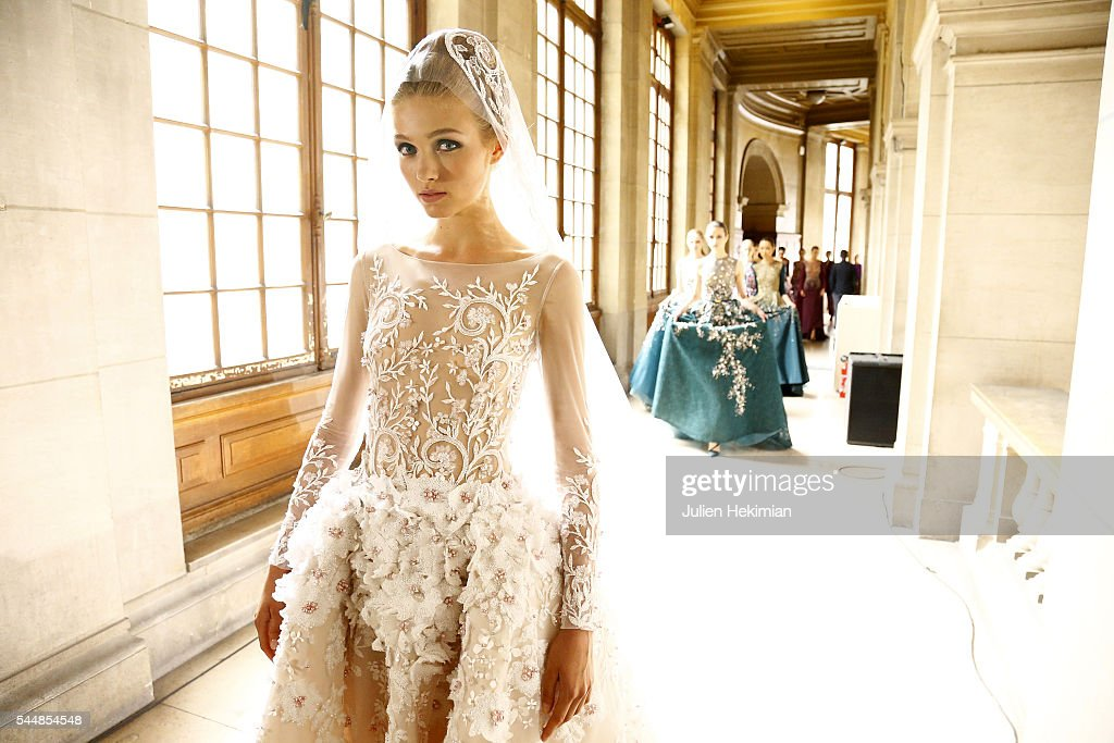 A model poses backstage during the Georges Hobeika Haute Couture Fall/Winter 2016-2017 show as part of Paris Fashion Week on at Ecole de Medecine on July 4, 2016 in Paris, France.