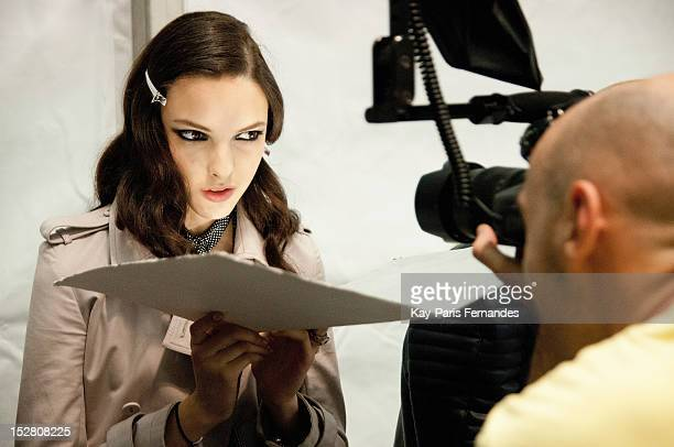 A model poses backstage for a photographer at Guy Laroche Spring / Summer 2013 show as part of Paris Fashion Week at Espace Ephemere Tuileries on...