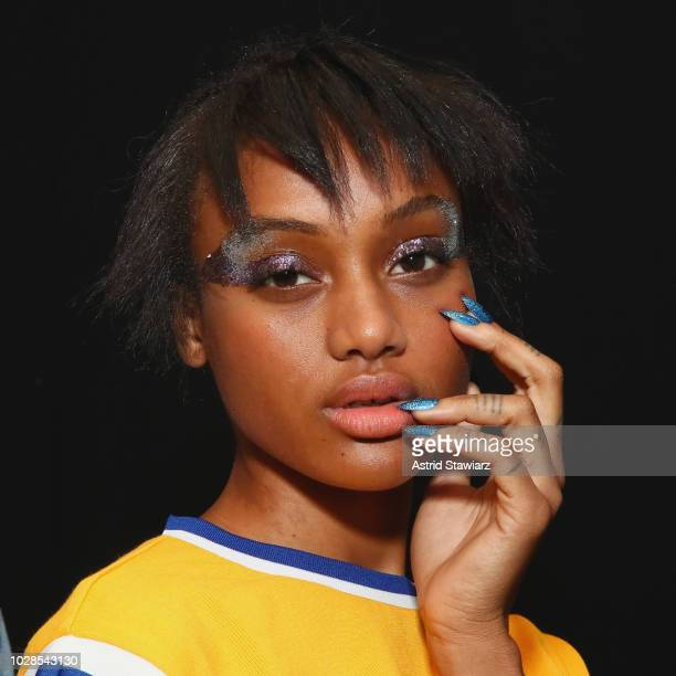 A model poses backstage for the Tadashi Shoji show during New York Fashion Week The Shows at Gallery I at Spring Studios on September 6 2018 in New...