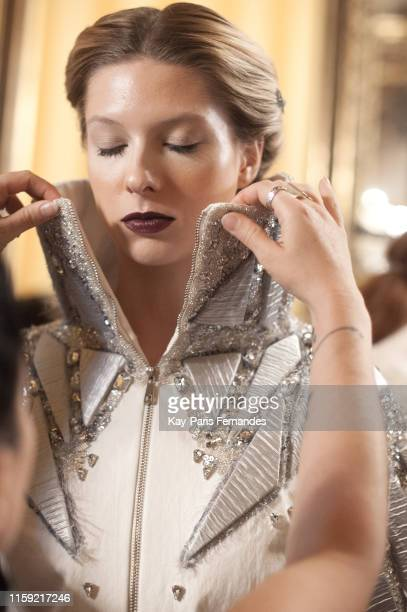 A model poses backstage prior th e Adeline Ziliox Haute Couture Fall/Winter 2019 2020 show as part of Paris Fashion Week on June 30 2019 in Paris...