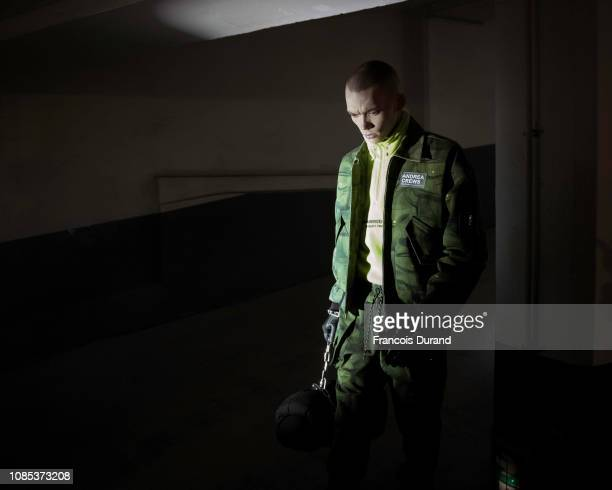 A model poses Backstage prior the Andrea Crews Menswear Fall/Winter 20192020 show as part of Paris Fashion Week on January 18 2019 in Paris France