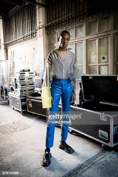 A model poses backstage prior the CMMN SWDN Menswear Spring Summer 2019 show as part of Paris Fashion Week on June 19 2018 in Paris France