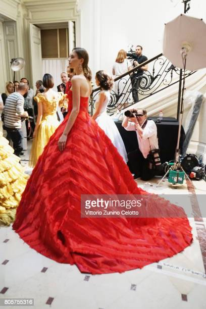 A model poses backstage prior the Guo Pei Haute Couture Fall/Winter 20172018 show as part of Haute Couture Paris Fashion Week on July 2 2017 in Paris...