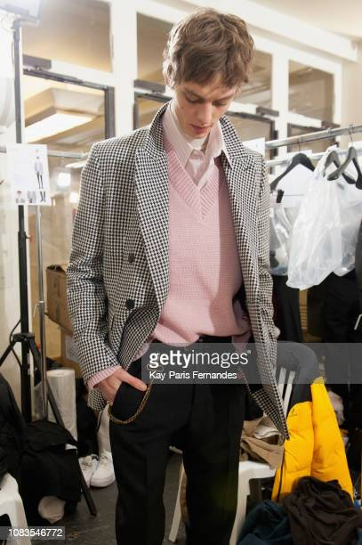 A model poses backstage prior to the Ami Alexandre Mattiussi Menswear Fall/Winter 20192020 show as part of Paris Fashion Week on January 17 2019 in...