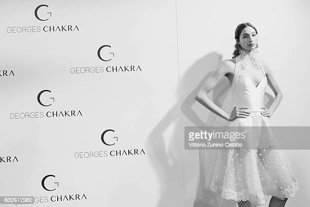 A model poses backstage prior to the Georges Chakra Spring Summer 2017 show as part of Paris Fashion Week on January 24 2017 in Paris France