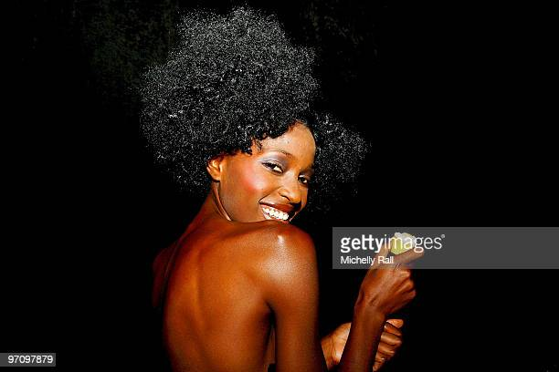 A model poses backstage prior to the Hip Hop fashion show at the 2010 Design Indaba Expo at the Cape Town International Convention Centre on February...
