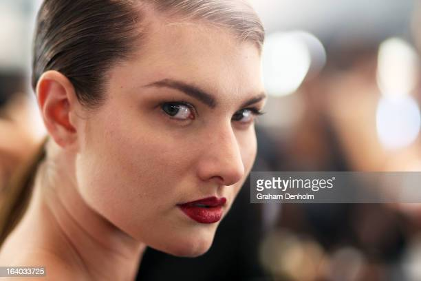 Model poses backstage prior to the L'Oreal Melbourne Fashion Festival Opening Event presented by David Jones at Docklands on March 19, 2013 in...