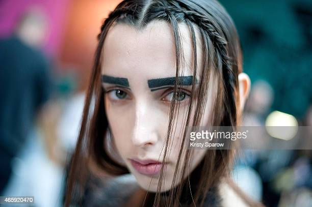 A model poses backstage prior to the Masha Ma show as part of Paris Fashion Week Womenswear Fall/Winter 2015/2016 at Palais de Tokyo on March 11 2015...