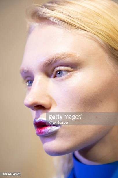 Model poses backstage prior to the Salvatore Ferragamo Fashion Show during the Milan Women's Fashion Week Fall/Winter 2021/2022 on February 27, 2021...