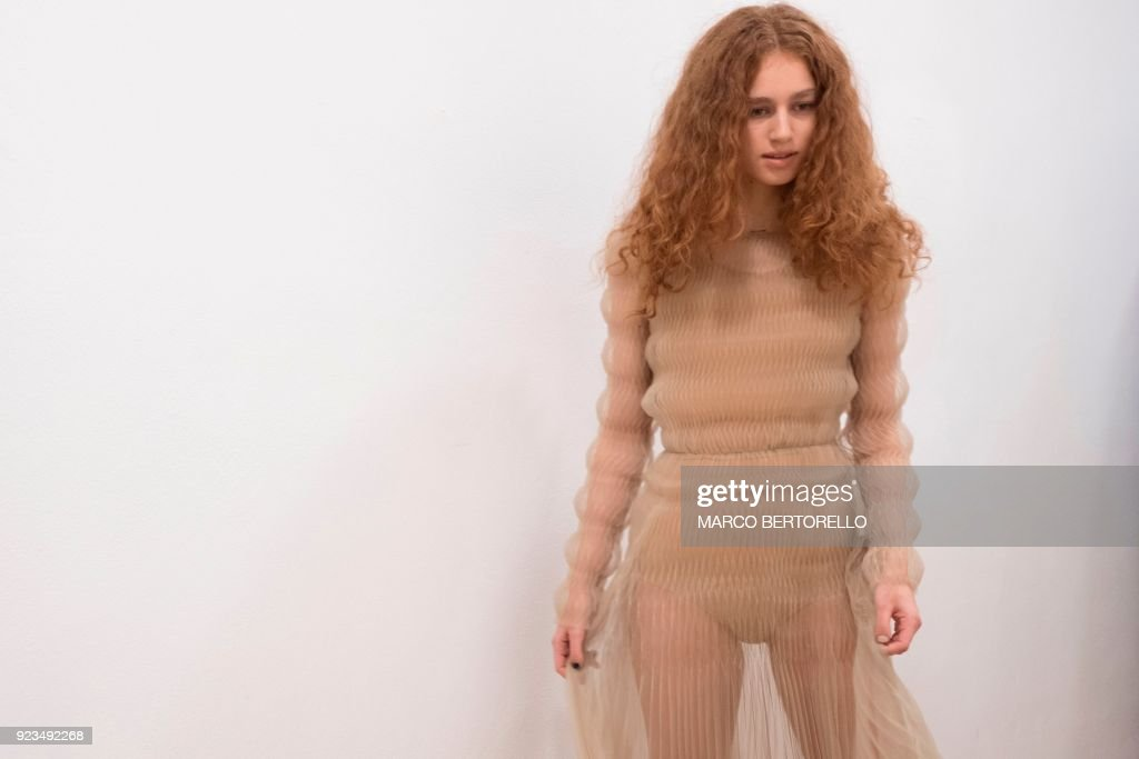A model poses backstage prior to the women's Fall/Winter 2018/2019 collection fashion show by Vionnet, in Milan, on February 23, 2018. / AFP PHOTO / Marco BERTORELLO