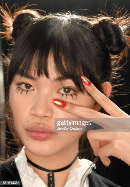 Model poses backstage with nails by CND for Jeremy Scott Fall/Winter 2017 on February 10, 2017 in New York City.