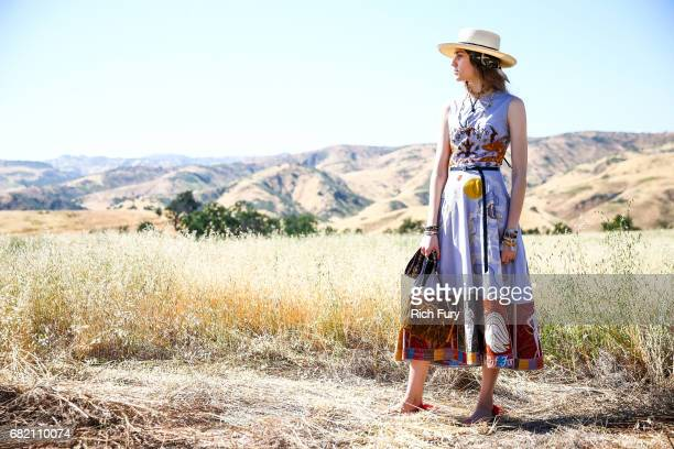 A model poses before the Christian Dior Cruise 2018 Runway Show at the Upper Las Virgenes Canyon Open Space Preserve on May 11 2017 in Santa Monica...