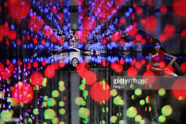 Model poses beside a Hyundai car during the media day of the Shanghai International Automobile Industry Exhibition at Shanghai New International Expo...