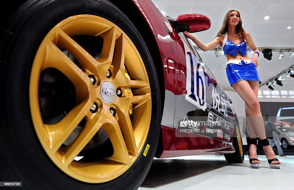 A model poses beside a Hyundai Elantra during a media preview at the Beiijng Auto Show on April 23, 2010. Auto sales in booming China hit 13.64 million in 2009, overtaking the United States, as increasingly well-off Chinese consumers continued to snap up cars, helped by government incentives such as lower taxes. AFP PHOTO/Frederic J. BROWN