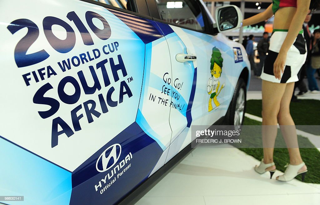 A model poses beside a Hyundai Santa Fe, decorated for this summer's football World Cup, during a media preview at the Beiijng Auto Show on April 23, 2010. Auto sales in booming China hit 13.64 million in 2009, overtaking the United States, as increasingly well-off Chinese consumers continued to snap up cars, helped by government incentives such as lower taxes. AFP PHOTO/Frederic J. BROWN
