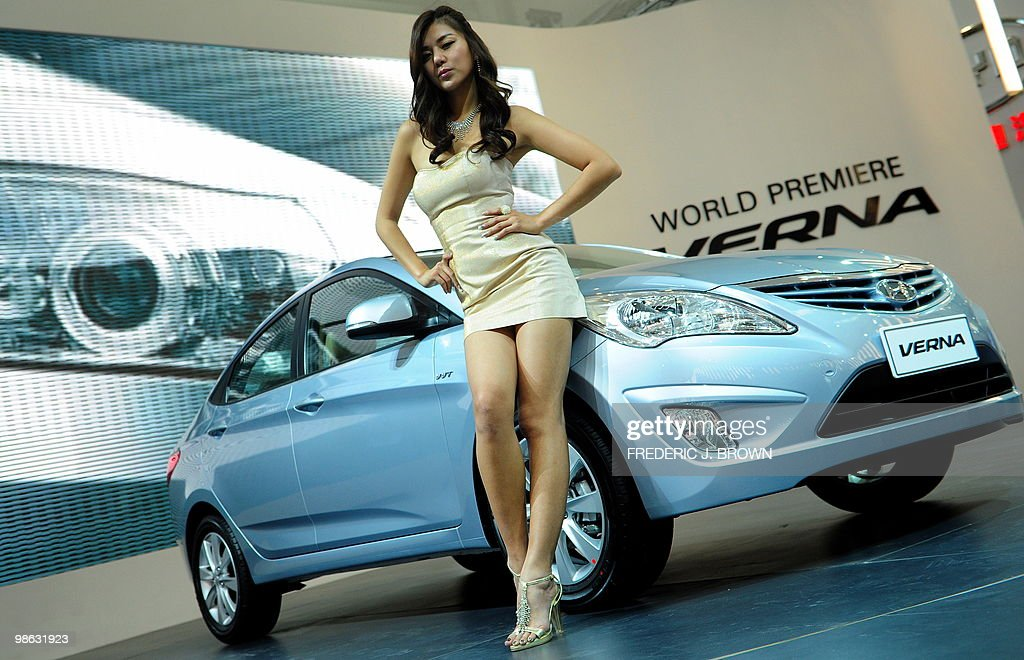 A model poses beside a Hyundai Verna at its world premiere during a media preview at the Beijng Auto Show on April 23, 2010. Auto sales in booming China hit 13.64 million in 2009, overtaking the United States, as increasingly well-off Chinese consumers continued to snap up cars, helped by government incentives such as lower taxes. AFP PHOTO/Frederic J. BROWN