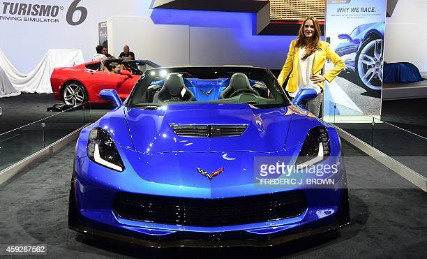 A model poses beside Chevrolet's 2015 Corvette Z06 on display at the LA Auto Show's press and trade day in Los Angeles California on November 19 2014...