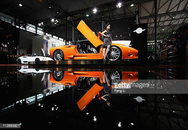 Model poses beside the Spyker C8 Aileron during the media day of the Shanghai International Automobile Industry Exhibition at Shanghai New...