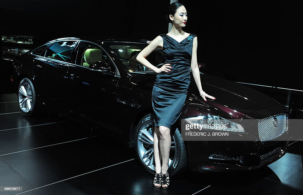 A model poses besides a Jaguar XJL during a media preview at the Beiijng Auto Show on April 23, 2010. Auto sales in booming China hit 13.64 million in 2009, overtaking the United States, as increasingly well-off Chinese consumers continued to snap up cars, helped by government incentives such as lower taxes. AFP PHOTO/Frederic J. BROWN