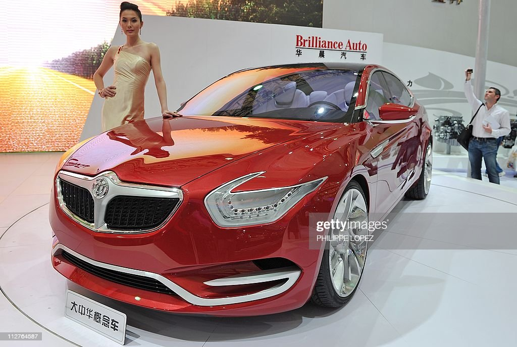 A Model Poses By A Suv Of Chinese Car Ma Pictures Getty Images