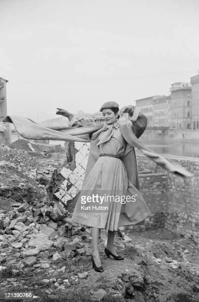 A model poses by the River Arno in Florence Italy 1952 Original Publication Picture Post 5685 Paris has a Rival pub 1st March 1952