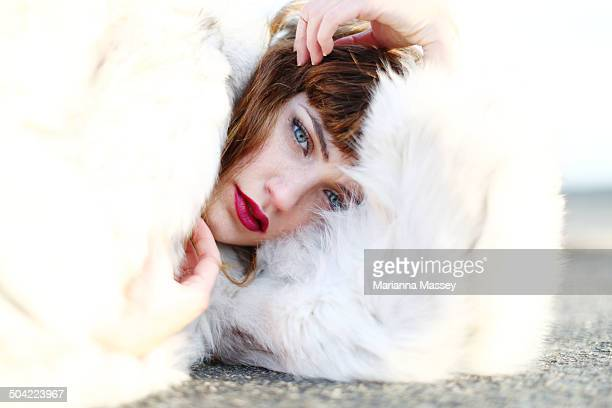 A model poses during a high fashion photo shoot