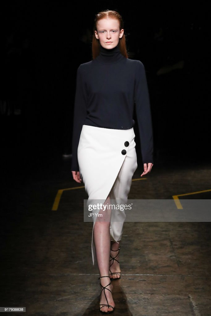 A model poses during BOSS Womenswear Gallery Collection during New York Fashion Week Mens' at Cedar Lake on February 13, 2018 in New York City.