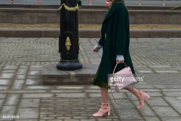 A model poses during Moscow MercedesBenz Fashion Week Fall/Winter 2017/18 in Moscow Russia on 15 March 2017