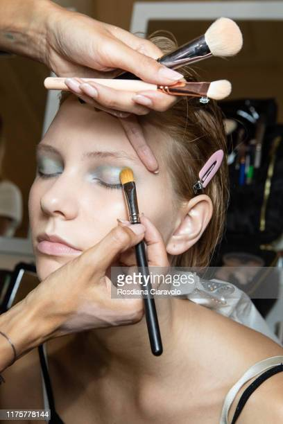 Model poses during the backstage for Tiziano Guardini fashion show during the Milan Fashion Week Spring/Summer 2020 on September 18, 2019 in Milan,...