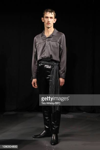 Model poses during the DANSHAN presentation during London Fashion Week Men's January 2019 at the Sarabande Foundation on January 06, 2019 in London,...
