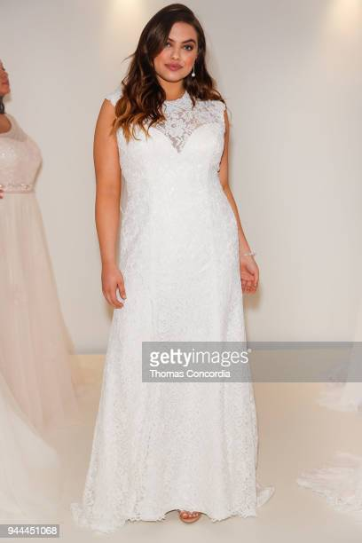 A model poses during the David's Bridal Fall 2018 Preview at Home Studios on April 10 2018 in New York City