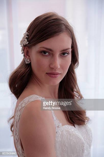 A model poses during the David's Bridal Spring/Summer 2017 presentation at Home Studios on April 19 2016 in New York City