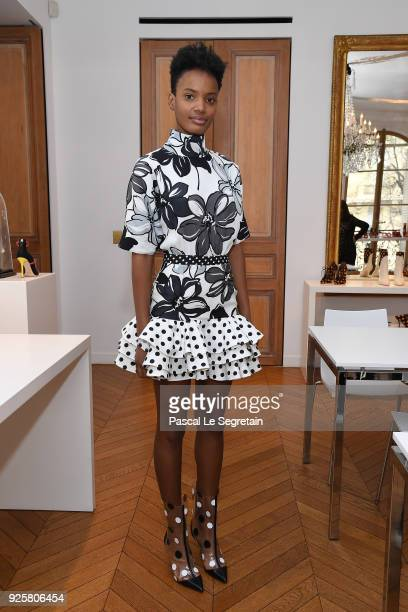 A model poses during the Emanuel Ungaro presentation as part of the Paris Fashion Week Womenswear Fall/Winter 2018/2019 at Avenue Montaigne on March...