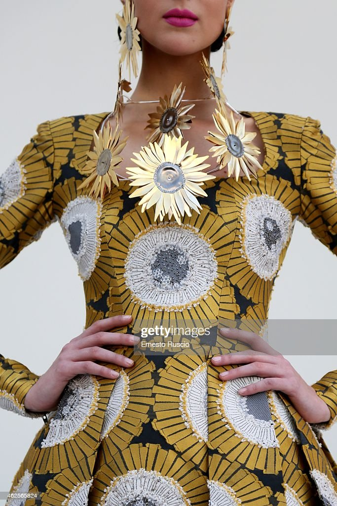 A model poses during the Gattinoni fashion show as a part ...