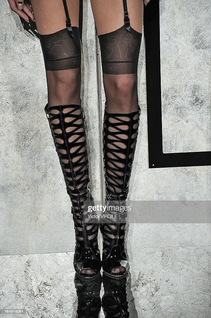 A model (Boot Detail) poses during the La Perla fall 2013 presentation during Mercedes-Benz Fashion Week at The Gallery at The Dream Downtown Hotel on February 7, 2013 in New York City.