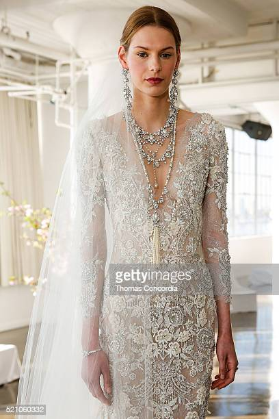A model poses during the Marchesa Bridal Spring/Summer 2017 Presentation at Canoe Studios on April 13 2016 in New York City