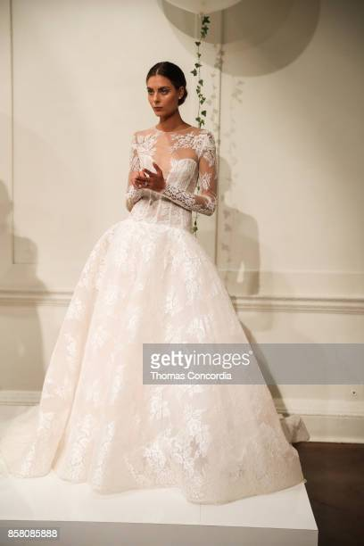 A model poses during the Monique Lhuillier Spring 2018 Bridal Presentation at the Academy Mansion on October 5 2017 in New York City