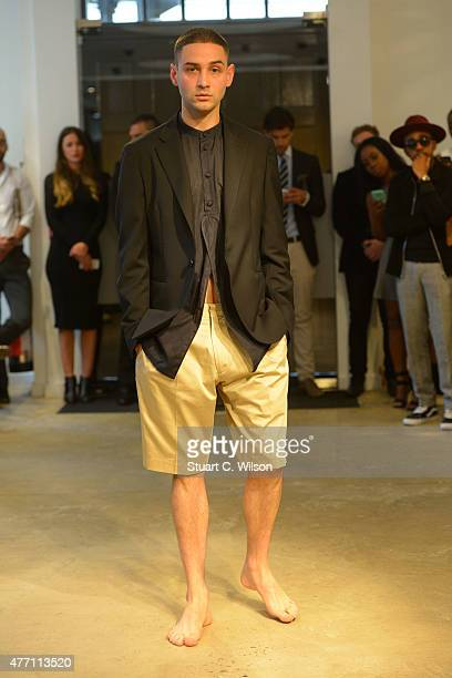 A model poses during the Spencer Hart presentation during The London Collections Men SS16 at on June 14 2015 in London England
