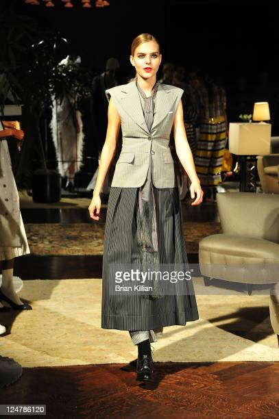 Model poses during the Thom Browne Spring 2012 presentation during Mercedes Benz Fashion Week at The New York Public Library on September 12, 2011 in...