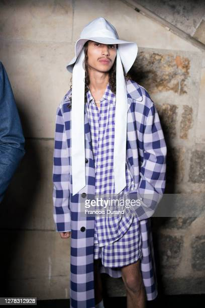 Model poses First Line ahead of the Ami Alexandre Mattiussi Womenswear Spring/Summer 2021 show as part of Paris Fashion Week on October 03, 2020 in...