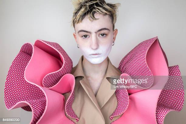 A model poses for a photo backstage ahead of the minki presentation during London Fashion Week September 2017 on September 19 2017 in London England