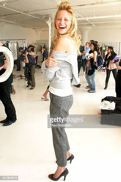 Model poses for a photo backstage at the Luella Bartley Spring 2005 fashion show during the Olympus Fashion Week Spring 2005 at Boylan Studios...