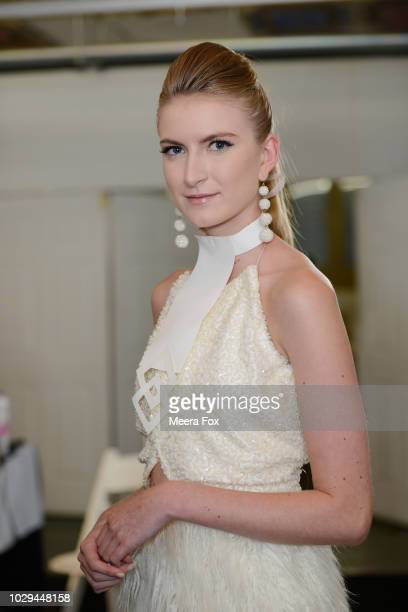 A model poses for a photo backstage during New York Fashion Week Powered By Art Hearts Fashion at The Angel Orensanz Foundation on September 8 2018...