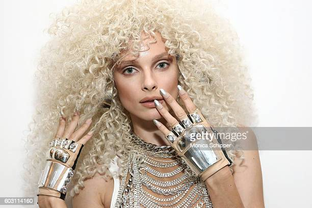 A model poses for a photo in finished hair and make up backstage at The Blonds fashion show during MADE Fashion Week September 2016 at Milk Studios...