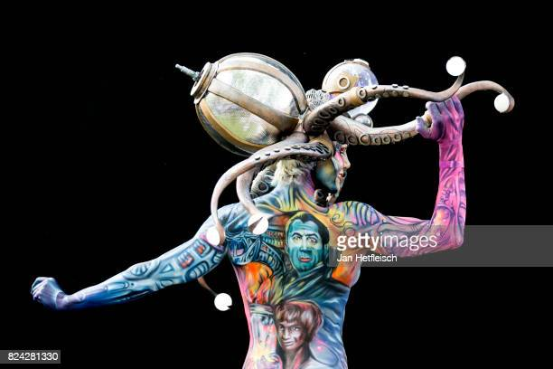 A model poses for a picture during the second day of the 20th World Bodypainting Festival 2017 on July 29 2017 in Klagenfurt Austria