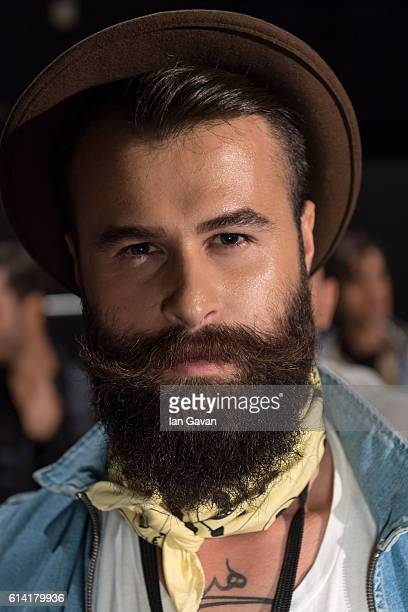 A model poses for a portrait backstage ahead of the Kigili show during MercedesBenz Fashion Week Istanbul at Zorlu Center on October 12 2016 in...
