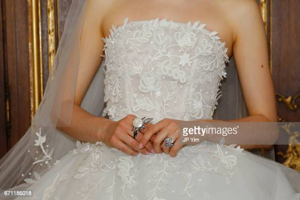 A model poses for first looks prior to the start of the Oscar De La Renta Bridal Spring 2018 show at The Morgan Library Museum on April 21 2017 in...